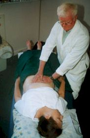 Dr. Kevin Alen administers manual abdominal therapy